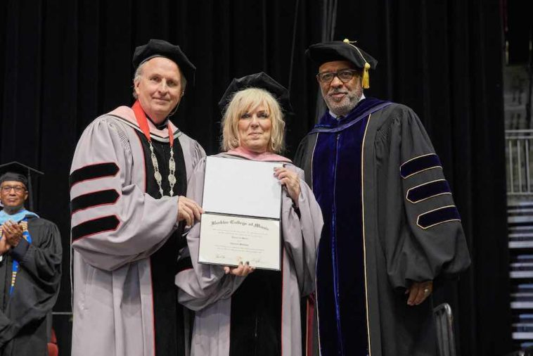 Lucinda Williams receiving honorary degree (L to R): Berklee President Roger H. Brown, Lucinda Williams, and Berklee senior vice president for academic affairs and provost Lawrence J. Simpson (photo credit: Dave Green)